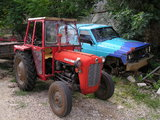 Tractor and a disabled vehicle in Medjugorje